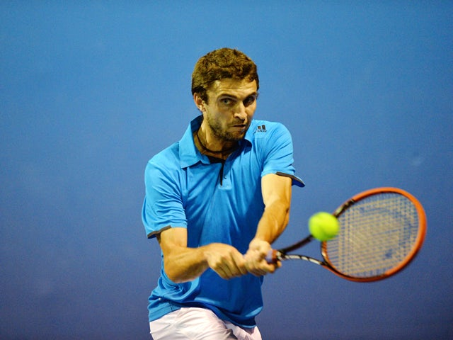 France's Gilles Simon plays a shot during his men's singles match against Croatia's Marin Cilic on day four of the 2014 Australian Open tennis tournament in Melbourne on January 16, 2014