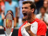Grigor Dimitrov celebrates after his win over Milos Raonic during their Australian Open third round match on January 18, 2014