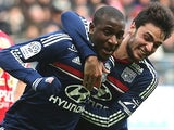 Lyon's Gueida Fofana celebrates with teammate Clement Grenie after scoring his team's second goal against Reims during their Ligue 1 match on January 19, 2014