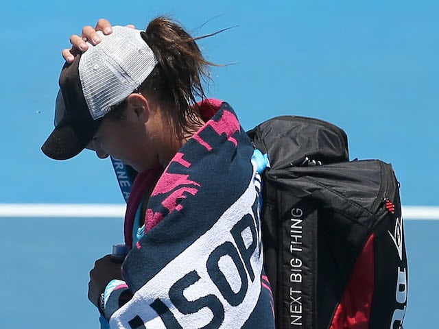 Heather Watson of Great Britain walks off after losing her first round match against Daniela Hantuchova of Slovakia during day one of the 2014 Australian Open on January 13, 2014
