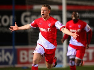 Kidderminster's Jack Byrne celebrates after scoring his team's second goal against Peterborough during their FA Cup third round replay match on January 14, 2014