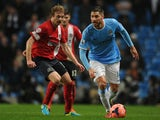 Javi Garcia of Manchester City competes with Chris Taylor of Blackburn Rovers during the Budweiser FA Cup Third Round Replay match on January 15, 2014