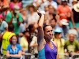 Jelena Jankovic celebrates victory over Kurumi Nara in their Australian Open third round match on January 18, 2014