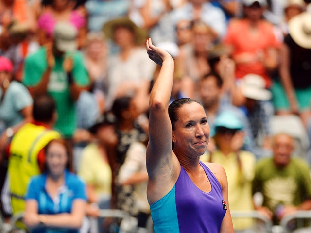 Jelena Jankovic celebrates victory over Kurumi Nara in their Australian Open third round match on January 18, 2014