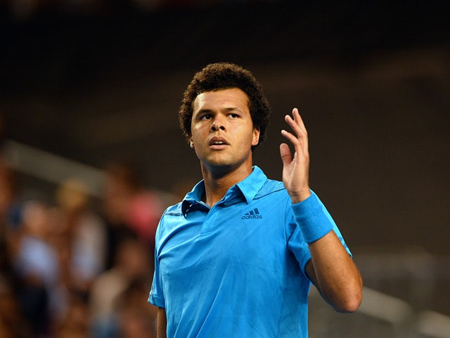 Jo-Wilfried Tsonga celebrates his win over Gilles Simon during their Australian Open third round match on January 18, 2014