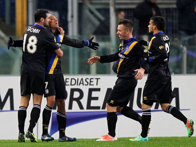 Parma's Jonathan Biabiany celebrates with teammates after scoring his team's first goal against Lazio during their Coppa Italia match on January 14, 2014