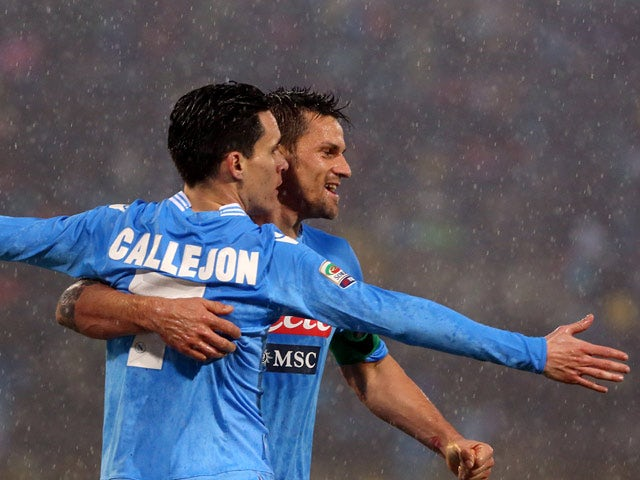 Napoli's Jose Maria Callejon celebrates after scoring his team's second goal against Bologna during their Serie A match on January 19, 2013
