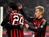 Keisuke Honda of AC Milan (R) celebrates during the TIM Cup match between AC Milan and AC Spezia at San Siro Stadium on January 15, 2014