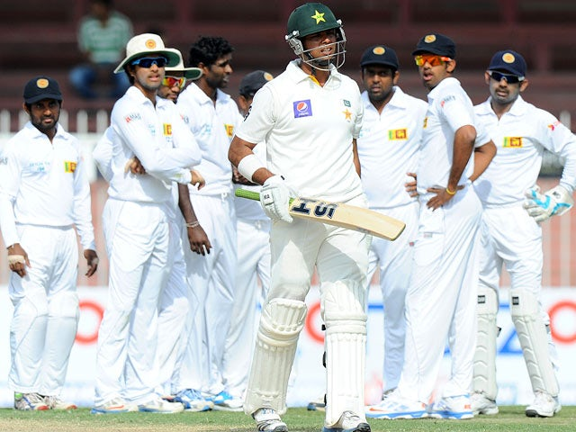 Pakistani batsman Khurram Manzoor leaves the field against being dismissed during the match against Sri Lanka on January 18, 2014