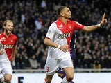 Monaco's Layvin Kurzawa celebrates after scoring the opening goal against Toulouse during their Ligue 1 match on January 19, 2014