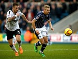 Millwall's Lee Martin and Ipswich's Luke Chambers in action during their Championship match on January 18, 2014