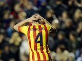 Barcelona's midfielder Cesc Fabregas reacts during the Spanish league football match Levante UD vs FC Barcelona at the Ciutat de Valencia Stadium in Valencia on January 19, 2014