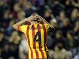 Barcelona's midfielder Cesc Fabregas reacts during the Spanish league football match Levante UD vs FC Barcelona at the Ciutat de Valencia Stadium in Valencia on January 19, 2014