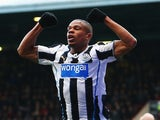 Loic Remy of Newcastle United celebrates scoring his teams second goal during the Barclays Premier League match against West Ham United on January 18, 2014
