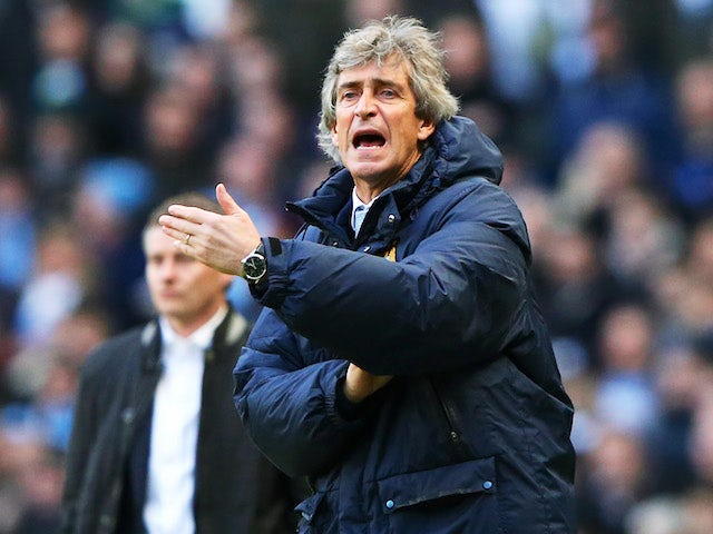 Manuel Pellegrini the Manchester City manager reacts as Ole Gunnar Solskjaer the Cardiff manager looks on during the Barclays Premier League match on January 18, 2014