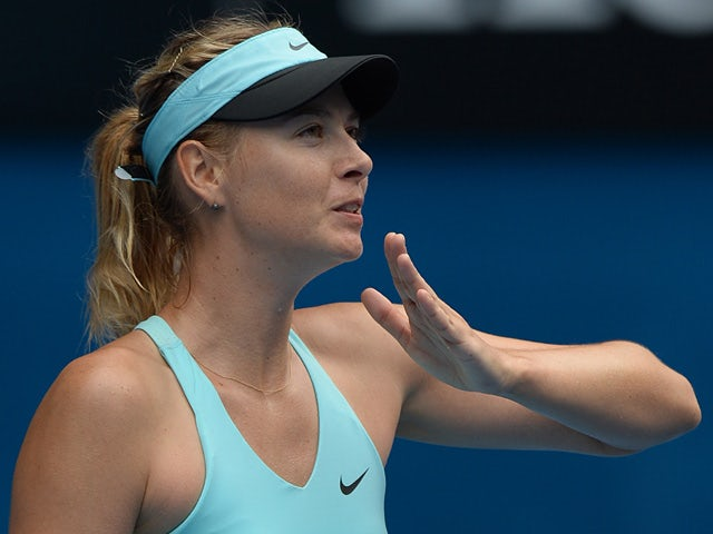 Maria Sharapova celebrates his win over Alize Cornet during their Australian Open third round match on January 18, 2014