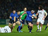 Leinster's Martin Moore breaks away from Ospreys' Adam Jones and Lloyd Peers during their Heineken Cup match on January 17, 2014