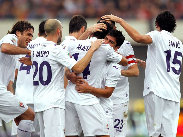 Fiorentina's Matias Fernandez is congratulated by teammates after scoring the opening goal against Calcio Catania during their Serie A match on January 19, 2014