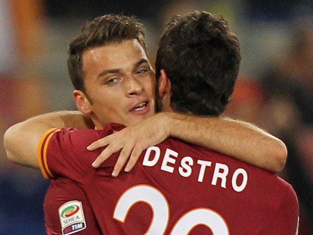 Mattia Destro with his teammate Adem Ljaijc of AS Roma celebrates after scoring the opening goal during the Serie A match against AS Livorno Calcio on January 18, 2014