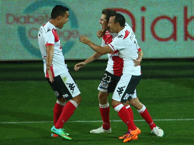 Mate Dugandzic of the Heart celebrates his second goal with team mates during the round 15 A-League match between Melbourne Heart and the Newcastle Jets at AAMI Park on January 17, 2014