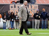 Cleveland Browns president Mike Holmgren greets people on the field prior to to the game between the Cleveland Browns and the Tennessee Titans at Cleveland Browns Stadium on October 2, 2011