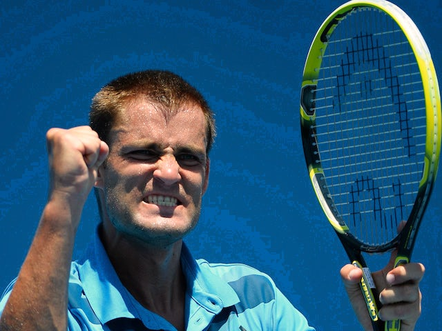Russia's Mikhail Youzhny gestures as he celebrates victory in his men's singles match against Germany's Jan-Lennard Struff on day one of the 2014 Australian Open on January 13, 2014