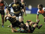 Montpellier's Lucas Dupont (L) is tackled by Treviso's James Ambrosini (R) during the European Cup rugby union match Montpellier vs Treviso at the Yves du Manoir stadium on January 18, 2014