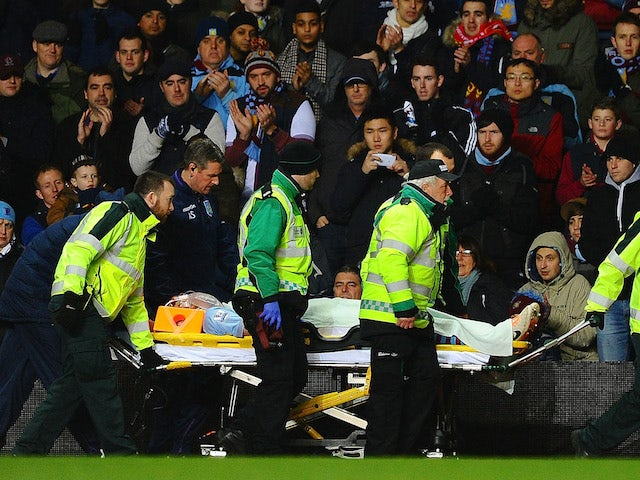Nathan Baker of Aston Villa is stretchered off during the Barclays Premier League match between Aston Villa and Arsenal at Villa Park on January 13, 2014