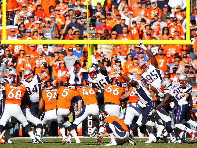 Matt Prater #5 of the Denver Broncos kicks a first quarter field goal against the New England Patriots during the AFC Championship game at Sports Authority Field at Mile High on January 19, 2014