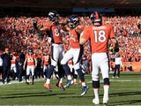 Jacob Tamme #84 celebrates his second quarter touchdown with Eric Decker #87 as Peyton Manning #18 of the Denver Broncos looks on during their AFC Championship game against the New England Patriots at Sports Authority Field at Mile High on January 19, 201