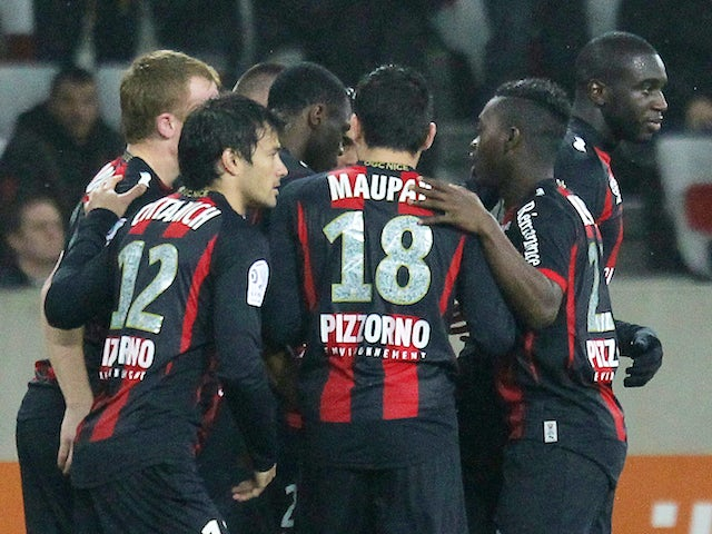 Nice's players celebrate after scoring a goal during the French L1 football match between Nice (OGCN) and Ajaccio (ACA) on January 18, 2014