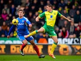 Nikica Jelavic of Hull City and Ryan Bennett of Norwich City compete for the ball during the Barclays Premier League match on January 18, 2014