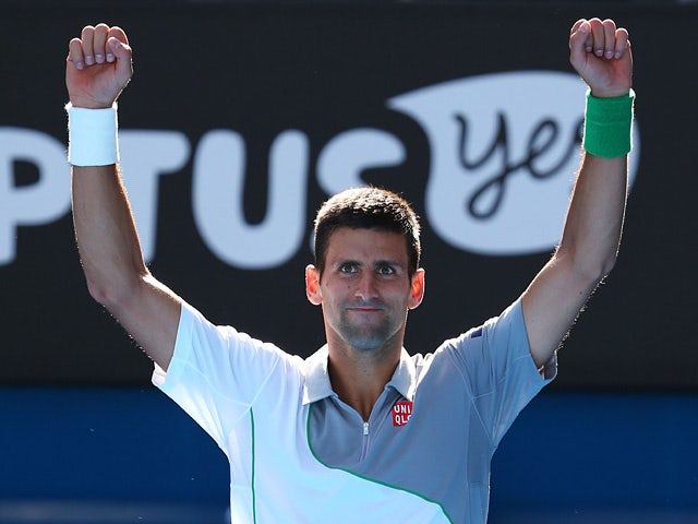 Novak Djokovic celebrates after his win over Fabio Fognini in their Australian Open fourth round match on January 19, 2014