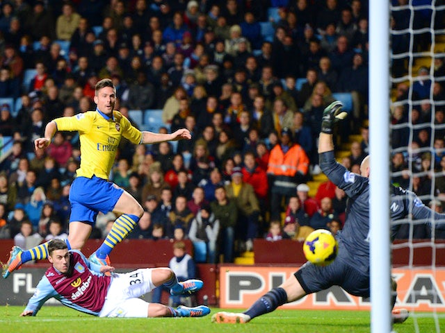 Olivier Giroud of Arsenal scores their second goal past Brad Guzan of Aston Villa during the Barclays Premier League match on January 13, 2014