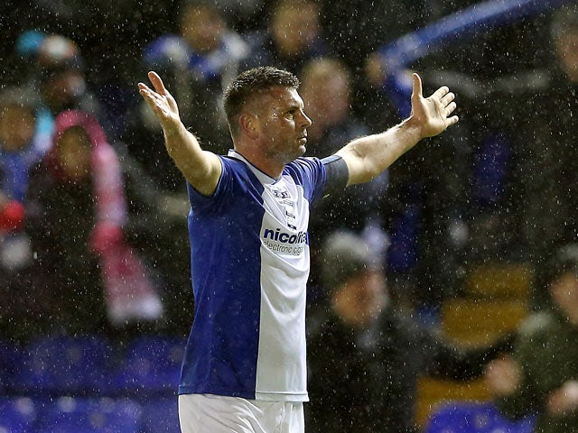 Birmingham's Paul Robinson celebrates after scoring the opening goal against Bristol Rovers during their FA Cup third round replay match on January 14, 2014