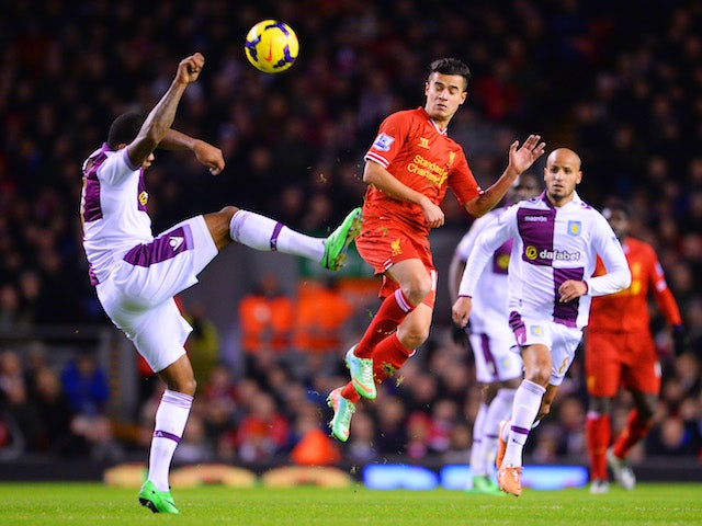 Philippe Coutinho of Liverpool challenges for the ball with Leandro Bacuna of Aston Villa during the Barclays Premier League match