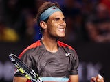 Rafael Nadal celebrates his victory over Gael Monfils in their Australian Open third round match on January 18, 2014