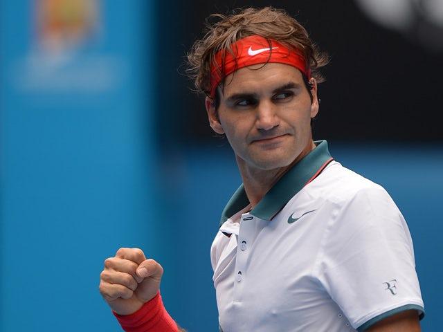 Roger Federer celebrates his win over Teymuraz Gabashvili during their Australian Open third round match on January 18, 2014