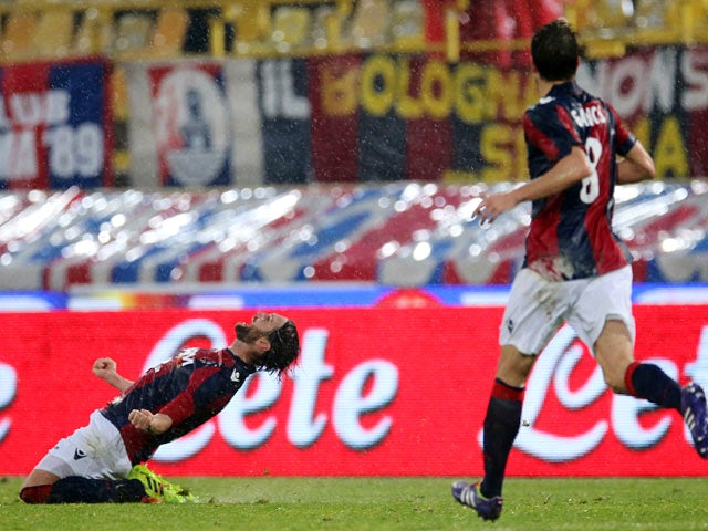 Bologna's Rolando Bianchi celebrates after scoring his team's second goal against Napoli during their Serie A match on January 19, 2014