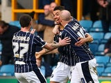 Millwall's Ryan Fredericks celebrates with teammates after scoring the opening goal against Ipswich during their Championship match on January 18, 2014