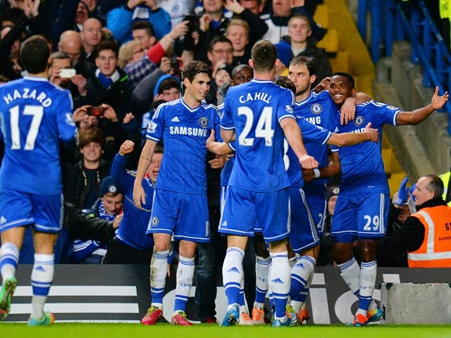 Chelsea's Samuel Eto'o celebrates with teammates after scoring his team's second goal against Man United during their Premier League match on January 19, 2014