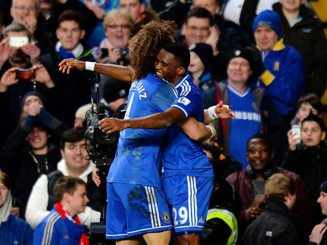 Chelsea's Samuel Eto'o celebrates with teammate David Luiz after scoring his team's second goal against Man United during their Premier League match on January 19, 2014