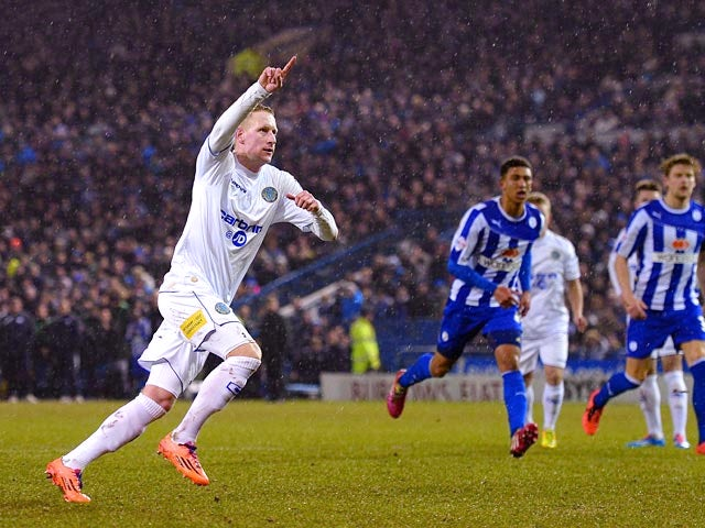 Macclesfield Town's Scott Boden celebrates after scoring his team's first goal via the penalty spot against Sheffield Wednesday during their FA Cup third round replay match on January 14, 2014