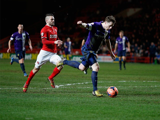 Oxford's Scott Davies scores his team's second goal against Charlton during their FA Cup third round replay match on January 14, 2014