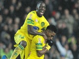Nantes' Togolese forward Serge Gakpe celebrates with his teammate Nantes' French defender Issa Cissokho after scoring during the French League Cup quarterfinal football match against Nice on January 15, 2014