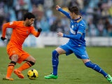 Real Sociedad's Carlos Vela and Getafe's Sergio Escudero in action during their La Liga match on January 19, 2014