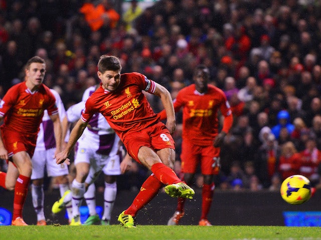 Steven Gerrard of Liverpool scores his penalty during the Barclays Premier League match between Liverpool and Aston Villa at Anfield on January 18, 2014