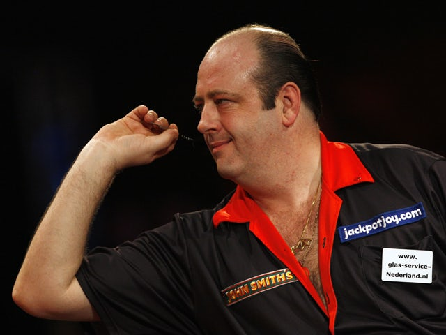 Ted 'The Count' Hankey of England prepares to throw a dart against Tony 'The Silverback' O'shea of England during The Lakeside World Darts Championships Final match at Lakeside in Frimley Green on January 11, 2009