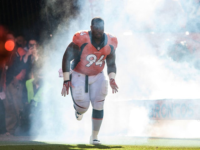 Terrance Knighton #94 of the Denver Broncos runs onto the field before a game against the Washington Redskins on October 27, 2013