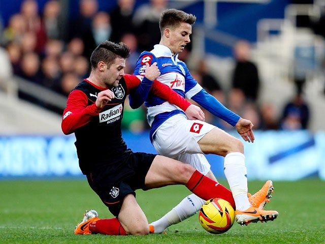 QPR's Tom Carroll and Huddersfield's Oliver Norwood in action during their Championship match on January 18, 2014
